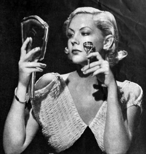 Above: 1934 June Knight using an eyelash curler from Kurlash to curl her false eyelashes.