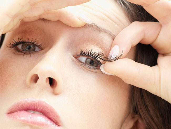 Makeup professionals apply lash glue to the false lash stri/band before placing it underneath your natural eyelashes as it creates a much more natural look!