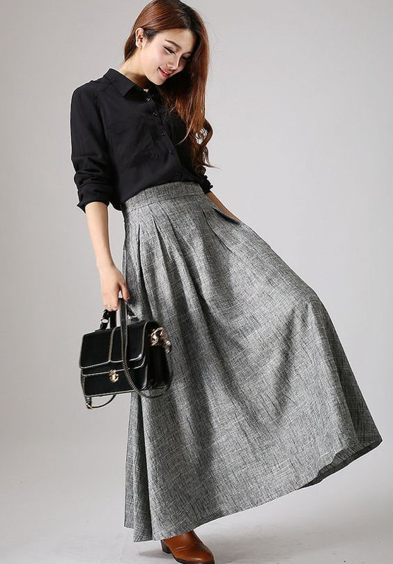 Black shirt with maxiplad skirt.